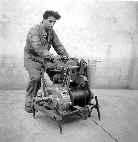 Worker operating a winch